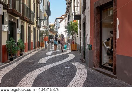 Funchal, Portugal - August 20, 2021: This Is One Of The Pedestrian Streets With A Mosaic Paving Patt