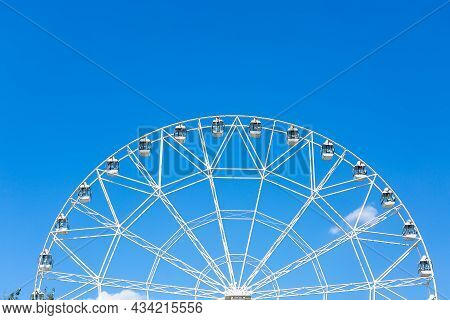 A Large White Ferris Wheel Against The Blue Sky On A Sunny Summer Day. Rostov-on-don.