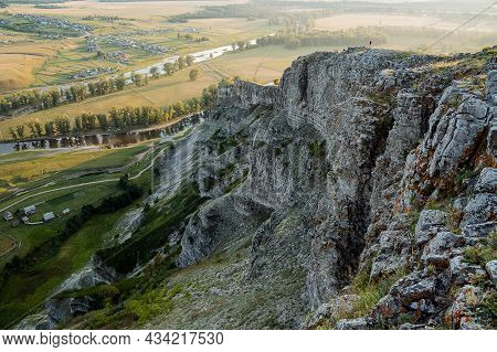 Magnificent View From The Mountain Range To The River And Houses In The Valley. At The Very Top Of T