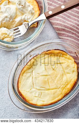 Delicious Cottage Cheese Casserole In Portioned Glass Forms With Sour Cream. Traditional Russian Cui