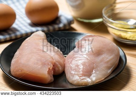 Chicken Fillet On A Cutting Board Ready For Grilling, Selective Focus. Raw Chicken Breast With Grill