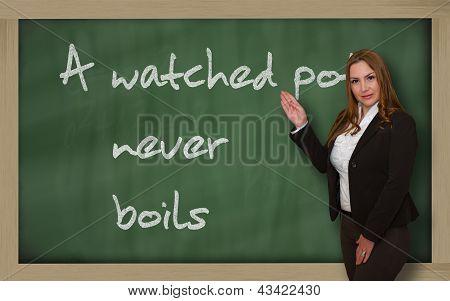 Teacher Showing A Watched Pot Never Boils On Blackboard