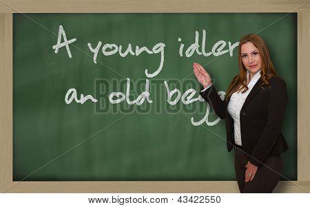 Teacher Showing A Young Idler, An Old Beggar On Blackboard