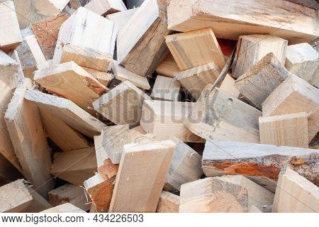 Waste From Wood Production. Firewood. Sawn Wood Cut Piled Perfectly As Backround. Waste Wood Timber