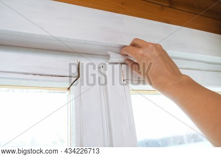 Woman Hand Insulating Old Windows To Prevent Warmth Heat Leak And Drafts, Preparing House For Winter