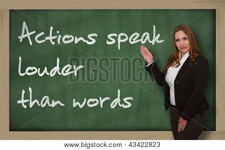 Teacher Showing Actions Speak Louder Than Words On Blackboard