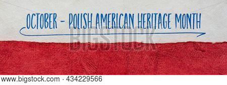 October - Polish American Heritage Month, handwritten note against a paper abstract in colors of Poland  national flag - white and red, reminder of celebration and cultural event