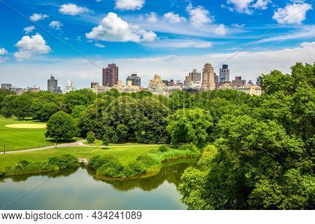 Panoramic View Of Manhattan Cityscape Over Turtle Pond In Central Park In New York City, Ny, Usa