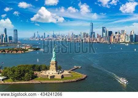 Panoramic Aerial View Statue Of Liberty And Jersey City And Manhattan Cityscape In New York City, Ny