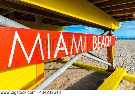 Close-up Of Miami Beach Sign On Lifeguard Tower In South Beach, Miami Beach In A Sunny Day, Florida