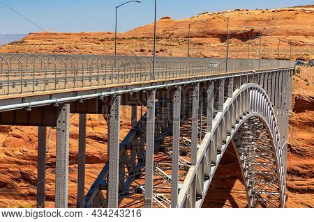 Glen Canyon Dam Bridge At Colorado River In A Sunny Day, Arizona, Usa