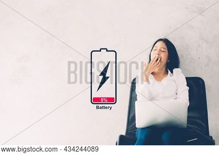 Young Asian Woman Yawn At Her Work Place With Laptop Computer On Cement Background, Girl Working Wit