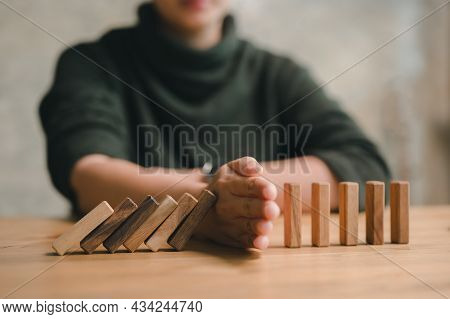 Hand Stopping The Domino Business Crisis Effect Or Risk Protection Concept, Business Solution And In