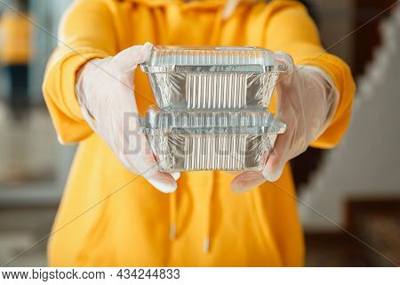Metal Takeaway Food Container To Go. Takeaway Food Delivery. Woman In Gloves Work With Takeaway Orde