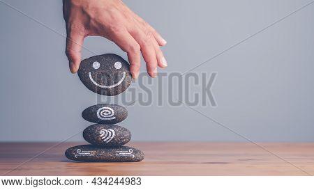 Hand Setting Zen Meditation Stone Stack To Balance. Balancing Body, Mind, Soul And Spirit. Mental He