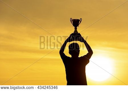 Winner Win Hands Holding Golden Champion Trophy Cup Prize. Silhouette Best Award Victory Hands Troph