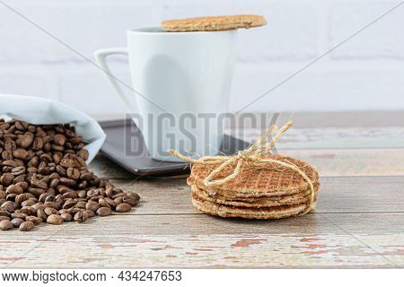 Stroopwafel Cookies With A Sisal Bow Next To A Cup Of Coffee (side View).