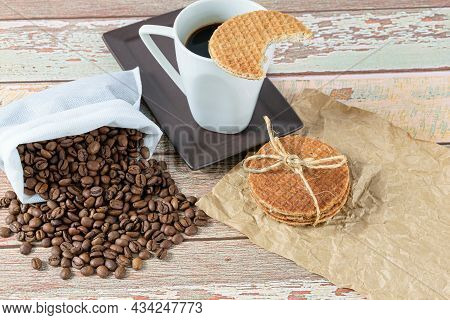 Stroopwafel Cookies With A Sisal Bow Next To Beans And Cup Of Coffee.