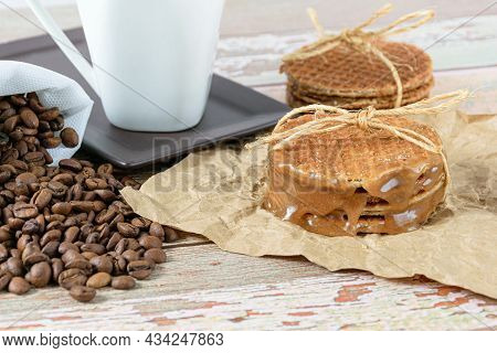 Stroopwafels Stacked On Brown Paper, Tied With Sisal String.