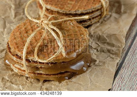 Closeup Of A Pile Of Stroopwafel On Brown Paper With Melted Glucose Syrup.
