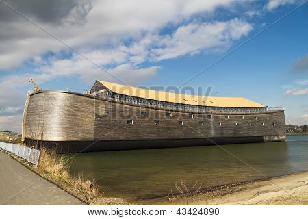 Full size wooden replica of Noah's Ark with yellow roof poster