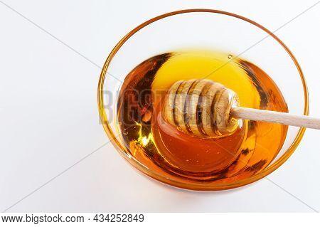 Sweet Honey. Healthy Organic Honey In A Bowl On White Background. Sweet Honey Healthy Dessert.