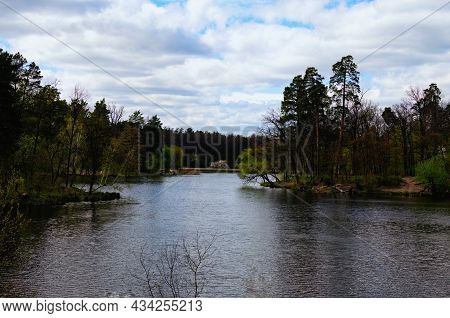 Astonishing Nature Landscape Of The Lake In The Forest. Trees Reflected In Tranquil Water. Spring Se