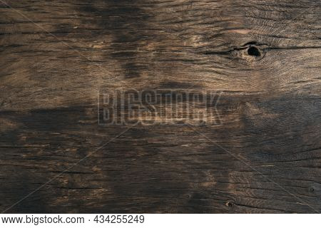 Black Textured Background On Brown Wooden Surface. Wooden Brown Background. Vintage Wooden Board. Co