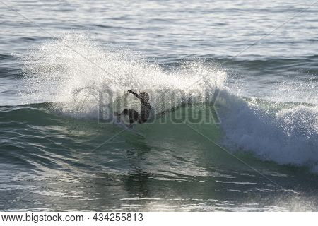 Surfer, Surfing The Perfect Wave. Pro Surf Training In The Sea Doing Maneuver. Ocean Water Extreme S