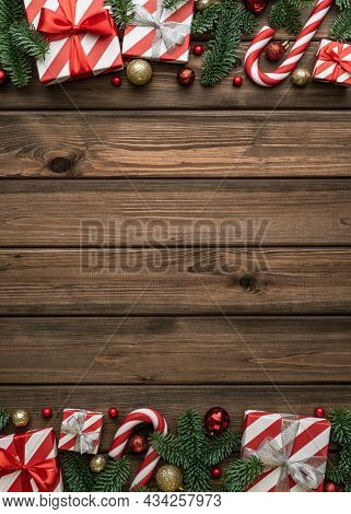 Christmas background with gift boxes and Christmas decorations on vintage wooden background. Flat lay, top view and copy space for text