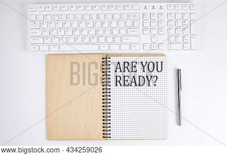 Are You Ready Text On The Notebook With Keyboard On The White Background