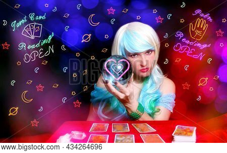 Psychic With Blond Hair And Crystal Ball. Vintage Neon Lights In Background