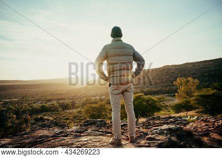 Caucasian Male Free Spirit Watching Sunset While Walking Through Wilderness Luscious Mountains