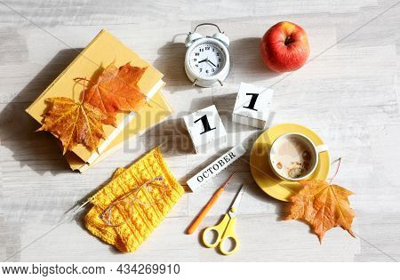 Calendar For October 11 : The Name Of The Month In English, Cubes With The Number 11, Books, An Alar