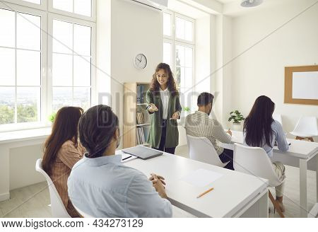 Female Teacher Communicates With A Group Of Adult Students At A Seminar In Advanced Training.
