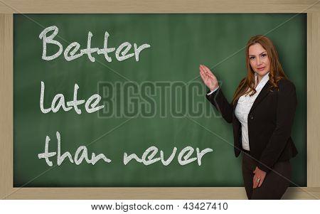 Teacher Showing Better Late Than Never On Blackboard