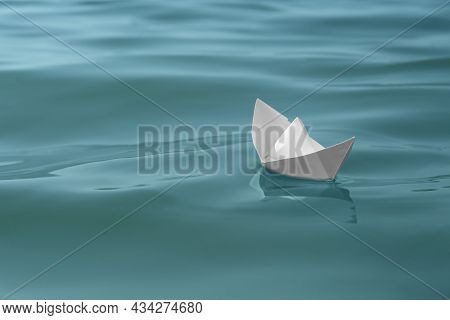White Paper Boat Floating On Water Surface, Space For Text