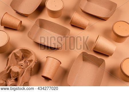 Eco-friendly Tableware And Kraft Paper Food Packaging On Kraft Paper Background - Paper Cups, Plates