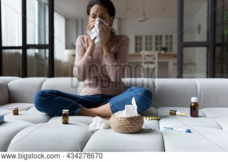 Unhealthy Woman Sneeze Suffering From Cold At Home