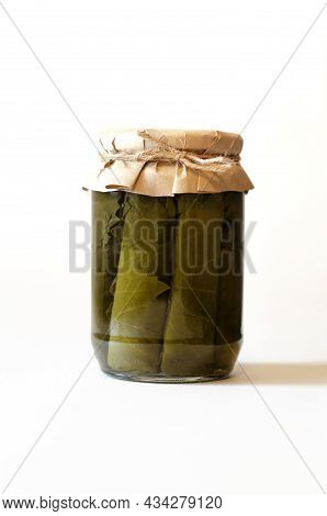 Dolma On A White Background, Isolate. Canned Dolma Leaves In A Jar. The Concept Of Storage, Harvesti