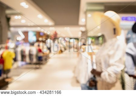 Woman Fashionable Boutique Clothing Store Window Display In Shopping Mall Blur Defocused Background