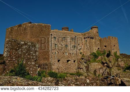 A View Of The Architectural Detail Of The Impressive Hilltop Castle Above Gorey Village On The Chann