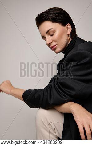 Fashion Studio Shot, Portrait Of Gorgeous Fashionable Attractive Brunette European Young Woman Posin