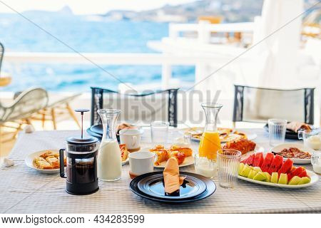 Delicious breakfast served at outdoor terrace of luxury villa