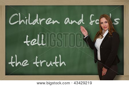 Teacher Showing Children And Fools Tell The Truth On Blackboard