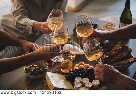 Friends Having Wine Tasting Or Celebrating Event With Wine