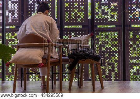 Bangkok, Thailand, Jul 04, 2020 : Work From Home Concept. Social Distancing Concept. A Lady Is Worki