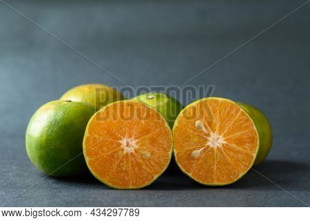 Fresh Half Green Tangerine Fruit On Color Background, Still Life
