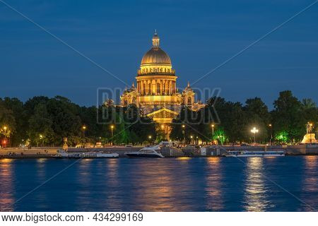St. Isaac's Cathedral in the night illumination and Neva river. Saint Petersburg, Russia