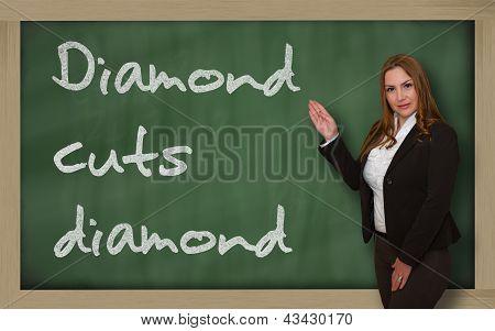 Teacher Showing Diamond Cuts Diamond On Blackboard